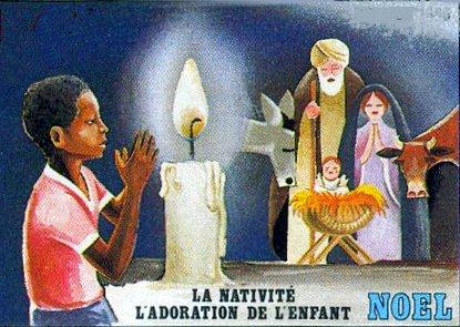 Afrique - Enfant priant devant la crèche